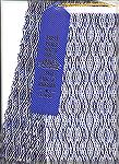 Here's my 8 shaft twill towel, complete with blue ribbon from the Va State Fair. It's actually very colorful - the scan probably won't show that too well. Pattern came from the Interweave 8-shaft book