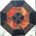 "This block is a modification of a block from Barbara Brachman's book ""Create Your Family Quilt"". The original is made up of 60 degree and 30 degree triangles and two uneven strips on each.  The puzzle"