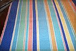 View shows all colors of tablecloth woven by Ramona Abernathy-Paine. Fibinacci numbers used to determine stripe width and spacing. Colors come from Fiesta Ware.