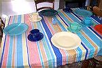 Here's the tablecloth I wove for my mother, along with some of her Fiesta Ware. I matched colors from the dishes for the stripes.