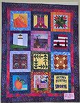 This quilt shows the blocks described in my review of the 2004 Atlanta Shop Hop.  This one was made by the In-Town Quilt shop and reflects their preference for batiks.  I share it since my description