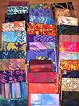 Here are the 33 batiks I collected from my participation in Atlanta's 2004 Quilt Shop Hop.  I arranged them for contrast and variety.  See the other picture for my daughter's transitional arrangement.