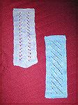 Alana Beyea's bookmarks, submitted in our 2004 Beverly Marchetti Memorial Bookmarks for literacy swap.  Vine lace and diagonal lace knitting, modified from a pattern by Darilyn Page at pagebypage.com.