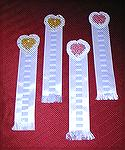 Bookmarks submitted by Becky Morgan in our 2004 Beverly Marchetti Bookmarks for Literacy Swap.  Becky's own design, with crocheted thread hearts and satin ribbon.