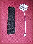 Bookmarks submitted by Dawn Wheeler in our 2004 Beverly Marchetti Memorial Bookmark Swap.  The black bookmark is Dawn's own design in knitted seed stitch, and the white one is crocheted from Julie A.