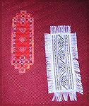 Karen's wonderful bookmarks were submitted for our 2004 Beverly Marchetti Memorial Bookmarks for Literacy Swap.  The red one is done in hardanger using Watercolours Pomegranate and Sampler Threads Pop