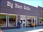 Laura Smith standing in front of Big Horn Quilts in Wyoming