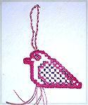 This hardanger cardinal is from New Zealand Creative Stitch and Craft.  Karen says it was orignally intended as a dove, but she stitched it as a cardinal, as she thought the bird looked more like one.