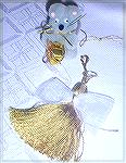 The little mouse with the package and the tassel angel are Colleen's own design.  From our 2005 Holiday Ornament Swap.