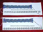 Maryse's bookmarks, from our 2006 Bookmark Swap. These are flat braids with beads, done on a takadai.