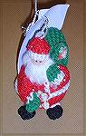 Becky's crocheted Santa is from Michele Wilson's Roly Poly Ornaments at freepatterns.com.  From our 2006 Holiday Ornament Swap.