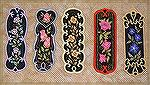 Bookmarks donated by Kyra Tenpenny. The bookmarks were machine embroidered. They are by oesd Mark My Words3. They are appliqued and embroidered.