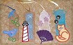 Bookmarks donated by Kyra Tenpenny. The bookmarks were machine embroidered. They are by Dakota Sewin' Big #30 Lace-themed Bookmarks. They are a combination of free standing lace and applique.