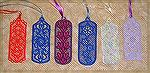 Bookmarks donated by Kyra Tenpenny. The bookmarks were machine embroidered. They are by http://www.oregonpatchworks.com under embroidery collections Ace Point Designs.