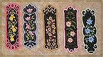 Bookmarks donated by Kyra Tenpenny. The bookmarks were machine embroideried. They are by oesd Mark My Words3. They are appliqued and embroidered.