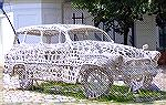 "Just stumbled across this.. was in a generic sort of post.. no info as to who, or where.. I doubt anyone can answer the ""why""!  It's a simple picture of somebody's crafting project - a knitted car scu"