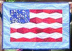 This flag wall hanging was made using tumblers die cut on my Studio cutter. Can be made in one afternoon.