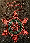 This snowflake is tatted from a pattern by Jennifer Williams. It was tatted by Wendy Durell.