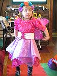 Eva in her 2015 Fairy outfit. She was trying to fly while we were trying to take a picture.