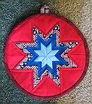 Round Amish folded star hot pad.