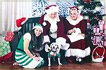 Lucy visiting with Santa, Mrs. Claus, and an elf. 2018.